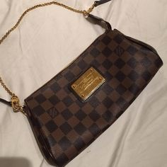 Louis Vuitton Eva clutch in Damier Lightly worn Eva clutch. Comes with receipt, original dust bag and box. No trade. No low ballers. Louis Vuitton Bags