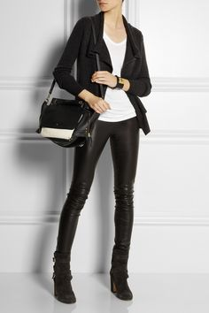 Shown here with: Chan Luu bracelet, Fendi cuff, Joseph pants, Gianvito Rossi boots, Jérôme Dreyfuss bag.