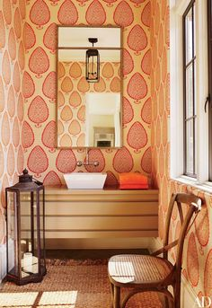 A Katie Ridder wallpaper from Holland & Sherry lines a powder room in an Atlanta home decorated by Suzanne Kasler.