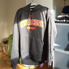 Under Armour Syracuse Sweatshirt/Hoodie Wore once or twice. In great condition! I bought it for myself but it's a men's medium. Under Armour Sweaters Shrugs & Ponchos