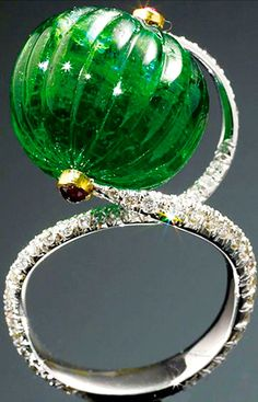 Santi Choudhary's Contemporary carved emerald bead ring