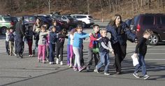 In this photo provided by the Newtown Bee, Connecticut State Police lead children from the Sandy Hook Elementary School in Newtown, Conn. Newtown Shooting, Newtown Connecticut, Sandy Hook, School Shootings, The Time Is Now, Gun Control, The Life, Believe In You, Elementary Schools
