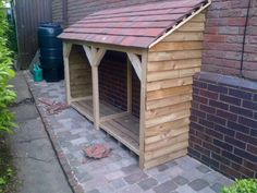 Homemade log store A dad thing. Firewood Shed, Firewood Storage, Log Burner Fireplace, Wood Burner, Garden Buildings, Garden Structures, Log Shed, Shed Design Plans, Wood Storage Sheds