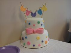 "I made this cake for a co-worker's baby shower.  It is a conglomeration of ideas I had seen various places. This was the first real cake I made-- it is kinda the ""cake that started it all"" and got me hooked on decorating.   TFL :)"