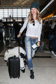 So fly! Behati Prinsloo ditched the makeup routine for a flight out of LAX on Friday ...