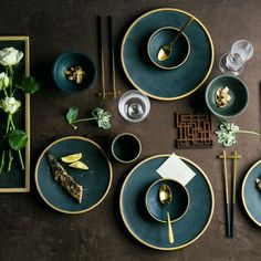 Dress your table with our eye-catching Asian Ceramic Dinnerware Set. The deep green and beige speckled design showcases a beautiful gold trim for everyday elegance. Authentic set includes: 1 bowl, 1 plate, 1 cup, 1 pair of chopsticks and chopstick holder Quality ceramic, chip-resistant durability, non-slip bottom Not recommended for dishwasher, microwave or oven