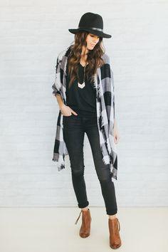 Black tee, black jeans, plaid scarf, ankle boots