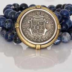 French Kande's stretch bracelet with beautiful medallion will be your go to piece for all your casual pieces. www.sageaccessories.com