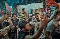 Palestinian men dance at a wedding party at Shuafat refugee camp in Jerusalem, Israel. - Adam Ferguson: I was attracted to this image as a result of the bright colours present within the frame. I was also attracted the joyful mood of the subject matter. Although the subject's are located in a refugee camp where they are faced with adversity, they still manage to engage in joyous and fun celebrations.
