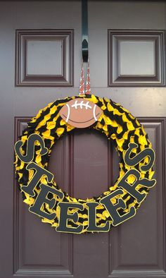 Eww these colors are Sooo UGLY....... However this will look AWESOME in COW*BOYS Colors!! Pretty wreath