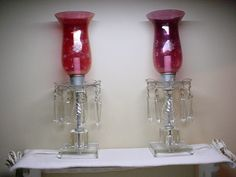 Mouse over image to zoom  Have one to sell? Sell it yourself  ANTIQUE PAIR HURRICANE LAMPS W/PRISMS & RUBY CRANBERRY GLASS ETCHED SHADES.  I actually have the chandelier that matches these...