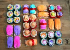 candy sushi  I liked the appearance of these candy treats but no recipe was included.  They are made from rice crispie treats and fruit roll ups and peeps. If I come across an actual recipe I will repin a new one :)