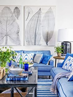 Punctuate a room with black when fitting | blue sofas with pillows | large black and white artwork prints | modern residential interior | interior design ideas | home decor ideas with blue | living room stylish