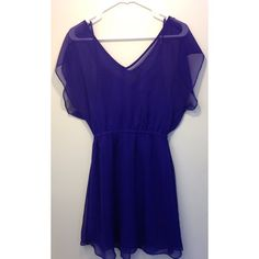 Flowy Purple Dress Purple dress with sheer overlay and silky slip. V neck and back. Super cute and flattering! It's the perfect bright purple color.   Please no trades or PayPal! Express Dresses