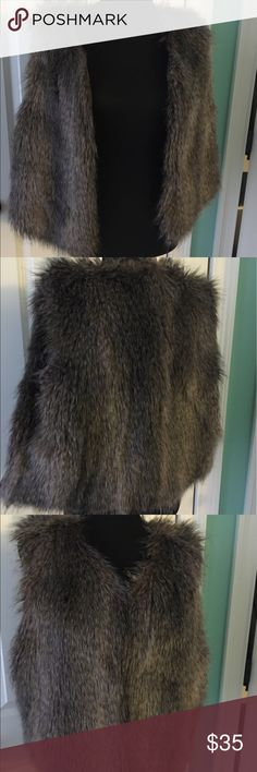 New York & Company Faux-Fur Vest Faux fur vest. Hooks to close up the front. Never worn. New York & Company Jackets & Coats Vests