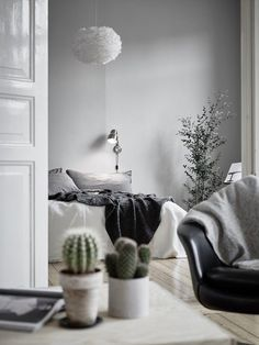 A beautiful grey and white bedroom. Vita Eos lamp shade available online | Bjurfors