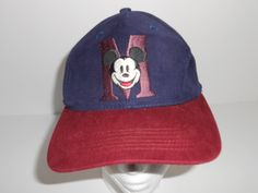 Check out this item in my Etsy shop https://www.etsy.com/listing/256168019/vintage-disney-mickey-mouse-m-navy-blue