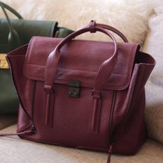 NWT Phillip Lim Pashli Aubergine Tote Burgundy NWT 3.1 Phillip Lim Pashli Aubergine Tote Burgundy. Comes with dust bag, receipt and tags. Purchased from saks fifth avenue. 3.1 Phillip Lim Bags Totes