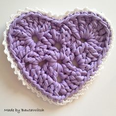 Purple crocheted pot coasters by BautaWitch