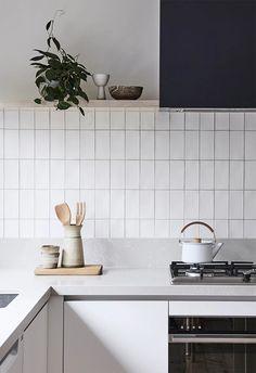 Kitchen backsplash with vertical stacking bond subway tile (via Bicker)