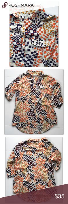 CAbi Grand Prix Button Down Tunic Blouse Size M CAbi  Grand Prix Geometric Button Down Tunic Blouse Size M  Great geometric print is chic and unique! A fun color year-round, but also perfect for Spring and Summer. This top is so versatile -- wear as a button-down tucked or untucked, a tunic (add a skinny belt and leggings!), or open. Material is 100% Rayon, so it's super soft and flattering!  Pre-owned condition. CAbi Tops Blouses