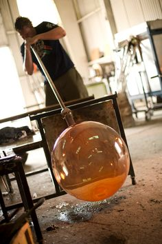 Justin Parker blowing glass at Esque Studio