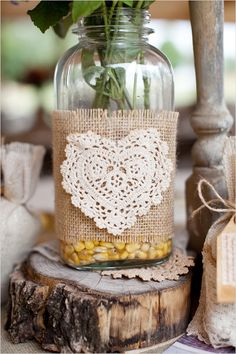 burlap wrapped mason jar @Melissa-Ella Seymour - You could use lace too, and then put a candle in it