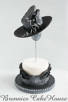 just some fun with fondant hats - Cake by Brenda Bakker