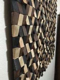 This original art piece is made from reclaimed, recycled and discounted wood. I cut, sanded and stained hundreds of individual blocks to form this piece. I used natural walnut & ebony stains for color and then applied coats of polyurethane to give it sheen and protect it from the