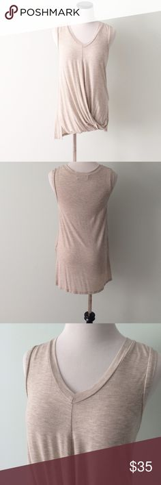 Tan twist front high low Top Beautiful twist front sleeveless top. Tops
