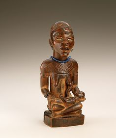 Seated Female with Child Artist: Master of Kasadi Date: 19th - early 20th century Geography: Democratic Republic of the Congo; Republic of the Congo; Angola, Cabinda Culture: Kongo peoples; Yombe group Medium: Wood (Nauclea latifolia Smith), glass, glass beads, metal tacks, pigment Dimensions: H. 10 1/8 in. (25.7 cm), W. 4 1/8 in. (10.5 cm), D. 4 in. (10.2 cm)