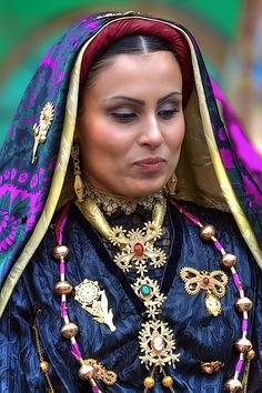 A beautiful example of traditional dress from one village in Sardinia. Notice the cameo and coral jewelry, both traditional crafts made on the island.