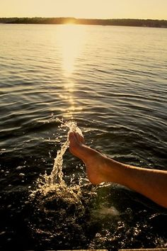Toes in the water...sun setting on the horizon...