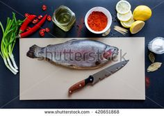 Fresh salmon lying on a black background - stock photo