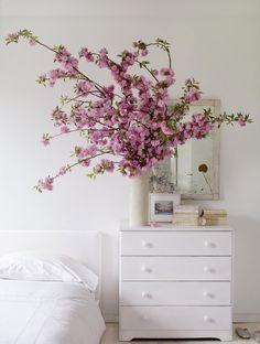 white dresser, fresh blossoms, clean palette, fresh bedroom  Pinterest: @Eman AlRais