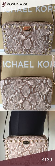 🆕MICHAEL KORS NEW CROSSBODY 💯AUTHENTIC MICHAEL KORS NEW  NEVER USED ROOMY CROSSBODY 100% AUTHENTIC. WHAT A STUNNING BAG! SO VERY STYLISH AND ON TREND. A AMAZING HIGH END LOOK AND SO PERFECT FOR THE WOMAN ON THE GO! THIS IS NOT A MINI! IT IS A REAL CROSSBODY. THIS WONDERFUL BAG HAS THREE ROOMY INTERIOR WALL POCKETS. IT ALSO HAS A LONG ADJUSTABLE SHOULDER/ CROSSBODY STRAP. THIS DELIGHTFUL BAG MEASURES 9.5 INCHES WIDE BY 6.5 INCHES TALL. A AMAZING BAG! THE COLOR IS CALLED DARK SAND. THE TAG…
