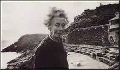 Rowena Cade financed & designed the Minack Theatre in the cliffs of Cornwall. When she was 38, she and two craftsmen built the first stage and seats. She developed techniques for wet cement work, inscribing lettering and Celtic motifs. She fetched sand up the steep way from the beach, and carried huge beams. She looked frail, but she worked in all sorts of weather until she was in her mid-eighties; just before her death at 89 she was still sketching ideas for improvements. More at link.