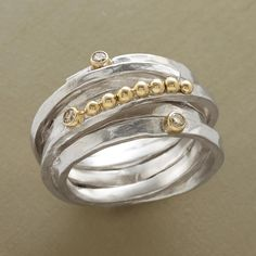 """ROULEAU RING--Our hefty, hand cast gemstone coil ring in sterling silver makes a dramatic setting for a parade of 14kt gold spheres and a sprinkling of diamonds in 14kt bezels. Exclusive. Whole sizes 6 to 9. Tapers 1/2"""" to 3/8""""W."""