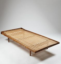 Ib Kofod Larsen Attributed; Walnut and Cane Daybed, 1950s.