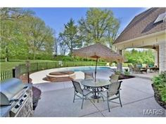 The perfect area for a BBQ. Large patio with grilling area and pool | 1314 Log Cabin Lane, Ladue, MO 63124