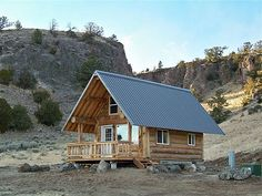 14 X 20  by Montana Mobile Cabins.  I like the overhanging metal roof creating a nice protected porch area in the front.
