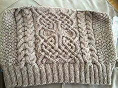 Celtic knot pattern!  It's a free download on Ravelry.  Nennir by Lucy Hague.