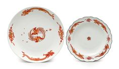 MEISSEN PORCELAIN 'RED-DRAGON' PLATE AND DISH  CIRCA 1735-40, BLUE CROSSED SWORDS MARKS, IMPRESSED DREHER'S MARKS E FOR ECKOLDT TO THE PLATE AND :: FOR GRUND SENIOR TO THE DISH Painted in iron-red and enriched in gilt with alternate red dragons and precious objects at the rim, one with two confronting phoenix to the center, the other with a Kakiemon flower-head, brown-line rim 11 5/8 in. (29.4 cm.) diameter, the dish (2)