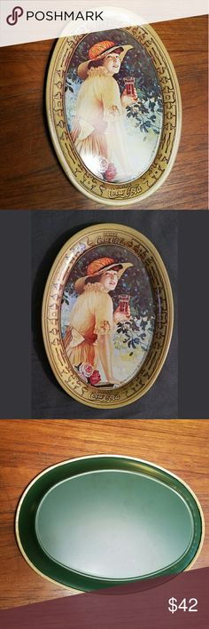 """*RARE* Vintage 1973 Coca Cola Tin Tray Awesome little piece of history. Photo is a 1917 depiction of a woman drinking a Coke mini. Trays/tins were printed in 1973. Great for holding jewelry or even used as a coaster. Approx 6 x 4.33"""" (I have a lot more Vintage Coca Cola in store & offer a 20% discount on 3+ items!) Vintage Other"""