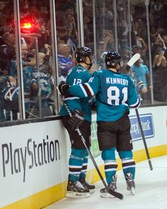 San Jose Sharks forward Tyler Kennedy celebrates with linemate Patrick Marleau after scoring a second period goal (Sept. 20, 2013).