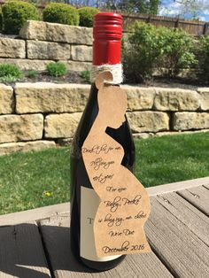 Unique pregnancy announcement! Wine or Liquor bottle tag. Custom, made to order! Fun & different! A personal favorite from my Etsy shop https://www.etsy.com/listing/289699069/pregnancy-announcement-wineliquor
