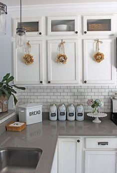 Simple Summer Kitchen Decorating ideas.   White kitchens, white cabinets with gray Quartz countertops.  #kitchenideas #whitekitchen