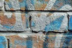 Interesting historical bricks with blue graffiti in Venice, in Italy, Europe.