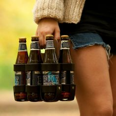 """Leather 4-Pack Holder. Walk into your favorite bottle market or brewery with a gorgeous lifetime leather 6 pack, nicknamed """"The Spartan Carton""""."""