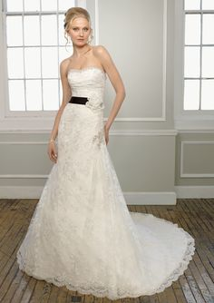 Mori Lee Style 1660 Embroidered Lace with Beading    Satin waist sash with flower comes in matching color to gown and black.